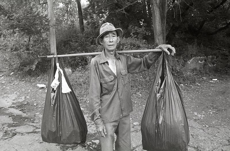 Man Collecting Aluminium Cans