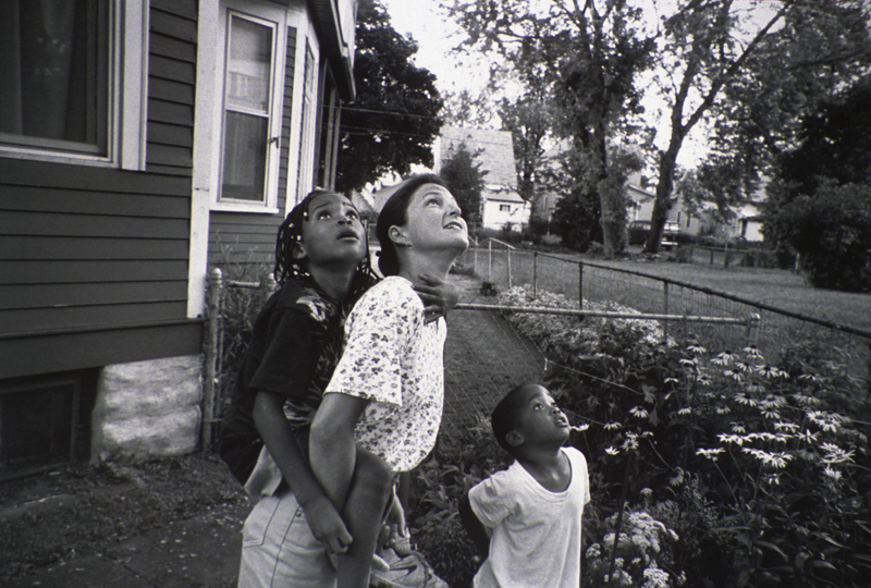 Woman With Two Children Looking Up